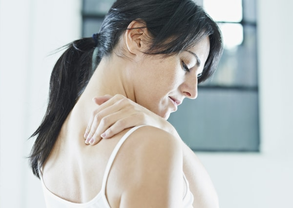 back pain woman rubbing neck