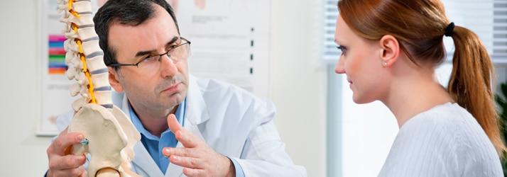 Chiropractor informing woman